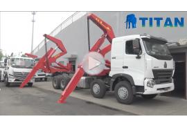 camión contenedor de carga lateral